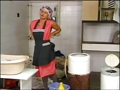 Laundering mature housewife in grey Pantyhose and curlers
