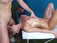 Oiled up brunette darling gets nailed in the massage parlor