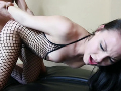 A woman in her fishnet suit is spreading her pussy for us all