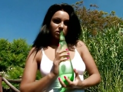 Large Boob Sweetie Fucks a Bottle Outdoors