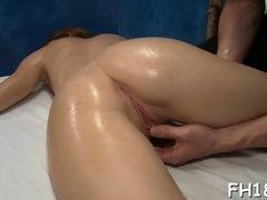 Oily babe has fun with her sex starved masseuse