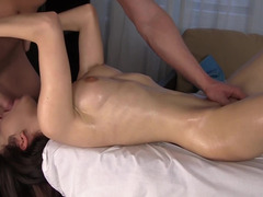 Oiled body beauty and her masseur fucking on the table