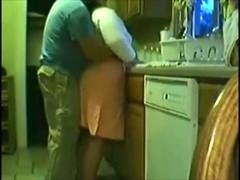 Amateur wife gets rammed from behind in the kitchen
