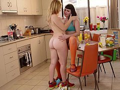 Kitchen action with two teen lezzies