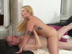 Natural tits bounce as the young blonde rides old cock