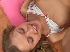 A sweet adorable blonde with pigtails is making love on the bed