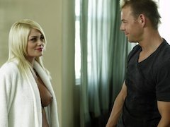 A blonde removes her robe and she gets massaged by her masseur