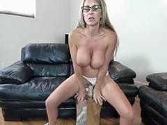 An sizeable breasted blonde floozy is riding on top of a large dildo for a live camera show