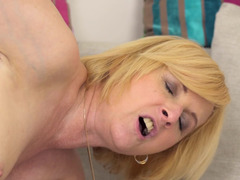 A granny that has a big ass is getting fucked by a young dude