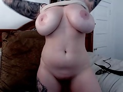 Thick, tattooed, busty babe with big natural boobs