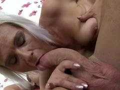 A granny gets banged by younger stud with his hard wooden tool