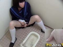 Asian teen is being spied on while taking a piss and masturbate in a toilet