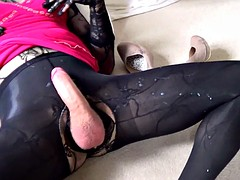 wanking my cock tranny with a huge load of cum on my pantyhose