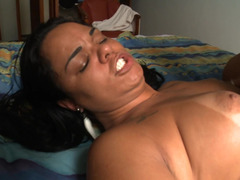 Latina with large tits and a large ass does anal sex on the bed