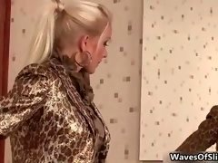 A couple of excited babes sucking huge penis trough