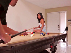 Cute girl is having a very sexy game of pool