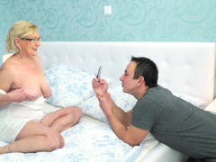 Granny with a nasty hairy pussy is fucked by a horny young man