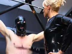 Domina in spandex catsuit tormenting scanty gimp