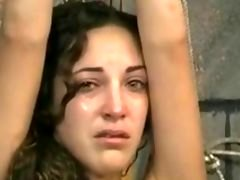 Sweet brunette is tied and made to cry by more experienced slave master