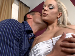 A blonde with large tits is opening up her wet pussy while in her heels