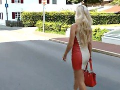 Sexy blonde lady wearing red and white leather