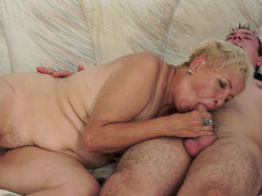 A fat granny is getting her cunt rammed doggy style by a young stud