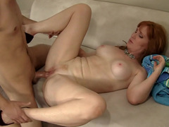 Redheaded cougar seduces him with her mouth and cunt