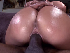 A large black shaft is going all the way inside a tight oiled up girl