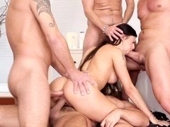 Hot thing gets a double penetration in the gangbang she is having
