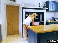 Mature mom seduces a young guy and fucks him in the kitchen