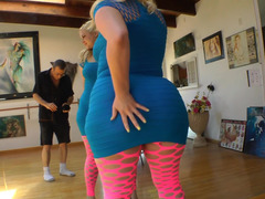 A fat blonde woman gets naked and she shakes her large ass