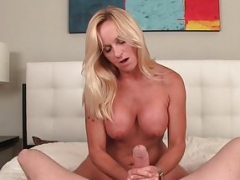 Busty mature cougar giving tugjob