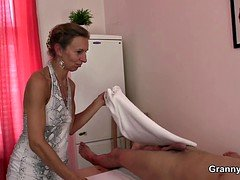 70 years old granny masseuse rides his cock