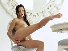 A brunette solo girl that loves to show off her shaved cunt jacks off
