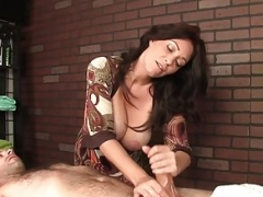 Busty dominant masseuse tugging user