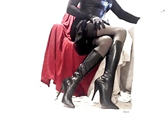 Kinky Crossdresser in black lingerie dress and boots