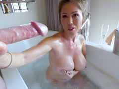 Sucking and stroking Asian milf babe in the bathtub