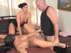 Two babes with delicious bodies are doing a hot threesome with a man