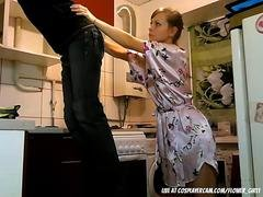 Cute housewife playing with her electrician on cam
