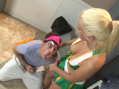 A busty blonde cheerleader is getting penetrated in the locker room