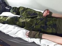On an army cot