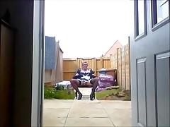 sissy ken in maids uniform in garden
