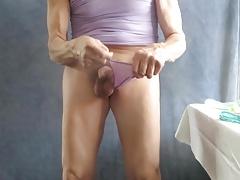 Sissy bitch pulls his panties down, masturbates on himself.