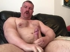 Beefy uncut stud fucks his toy