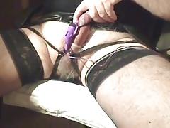 Cum in condom plays with clit stimulator