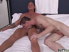 Allen leans over and begins sucking Zack