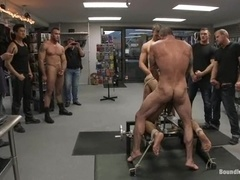 A hunk gets banged and humiliated by a few gays in a shop
