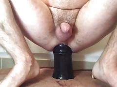Riding giant black dildo