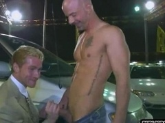 Excited lads make love at car sale
