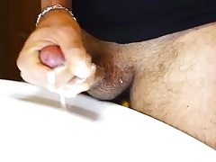 Jerking at the bathroom